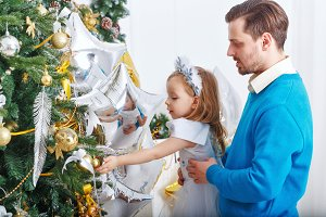 Family decorate Christmas tree