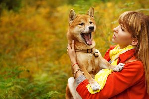 Girl and dog Shiba Inu