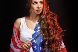 Girl wrapped in a US flag