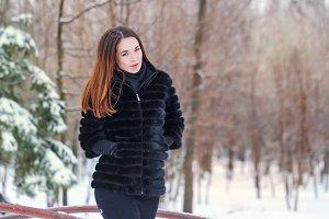 Portrait of a cute girl fur coat.