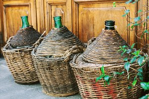 Vintage empty wicker wine bottles