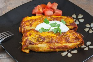 Enchiladas with tomatoes and sour cr