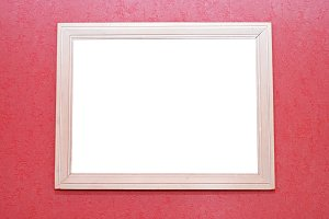 white empty frame on the pink wall