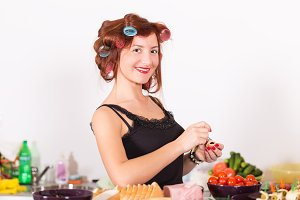 Young pretty woman housewife cooking