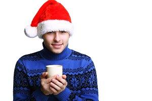 man in Santa's red hat