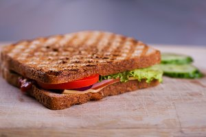 Fresh homemade grilled sandwich on wood