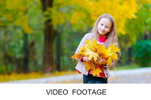 Girl with orange leaves bouquet