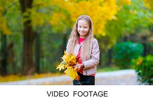 Adorable girl beautiful autumn day