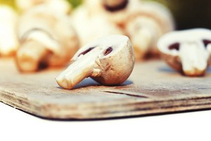 champignons on a wooden background