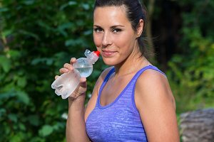 Woman drinks water plastic bottle