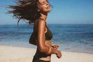 Young woman in bikini running