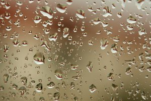 Glass with drops of rain water