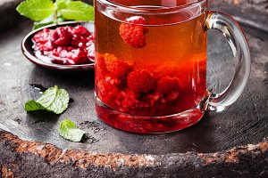 Hot tea with raspberry