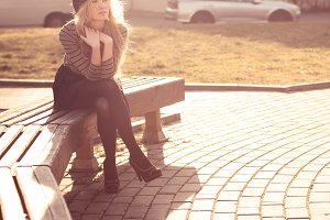 cute girl sitting on a bench
