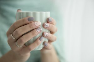 woman's hands holding a cup of mint