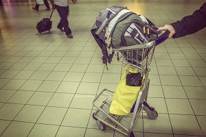 Hand luggage on a cart in airport