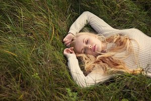 cute blonde sleeping on grass