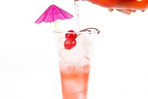 pour the lemonade into the glass