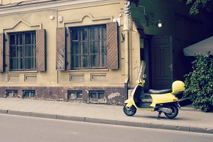 Yellow scooter on the street