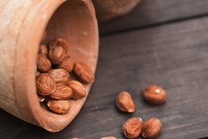 hazelnut on a wooden background outdoors
