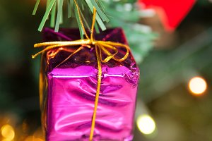 Christmas pink present box baubles on tree