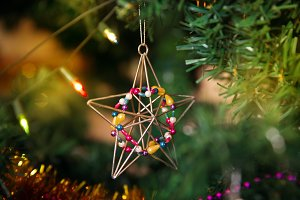 Christmas star baubles on tree