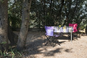Table and chairs on campsite
