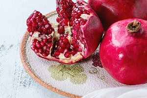 Slice and whole pomegranates