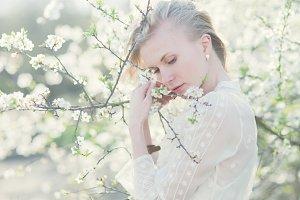 Pretty girl near a flowering tree