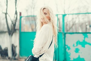 long-haired blonde with a handbag