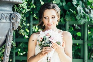Bride, peonies and bumblebee