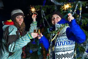 Two women celebrate Christmas