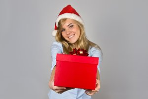 Blonde woman with Christmas present