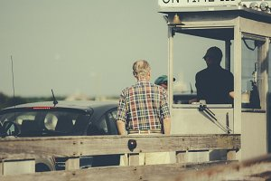 Old Man on a Car Ferry to Island