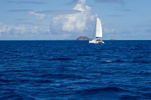 Sescape of sailboat passing island