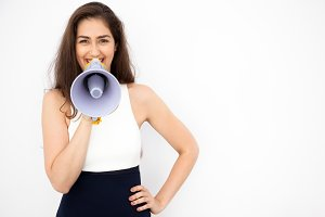 Young beautiful Caucasian woman shouting and making announcement with megaphone in white isolated background