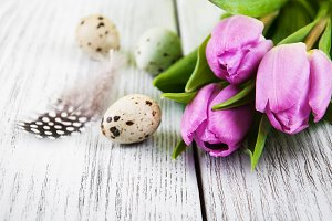 Eggs and pink tulips