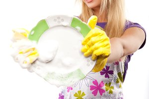 housewife in yellow gloves
