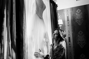 Bride holds her wedding dress