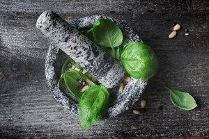 A stone mortar and basil pesto