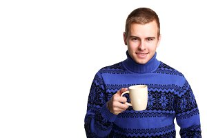 man in blue sweater with white cup