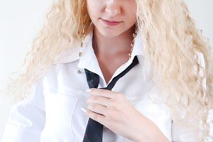 A blond girl is dressed
