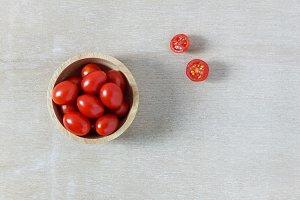 Fresh tomato on bowl.