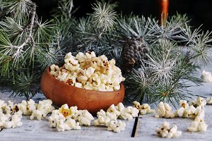 New Year or Christmas composition with popcorn, hazelnuts