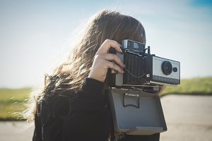 Girl Taking Photo with Film Camera