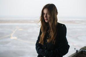a frozen girl in a black dress