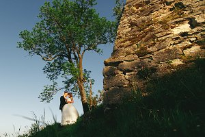 Just married stand behind a wall