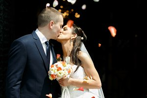 Just married couple kisses