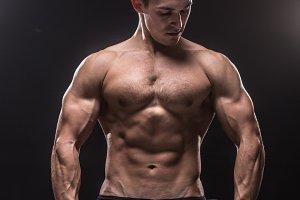 Bodybuilder dark black background