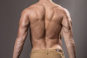 Bodybuilder back rear view muscles